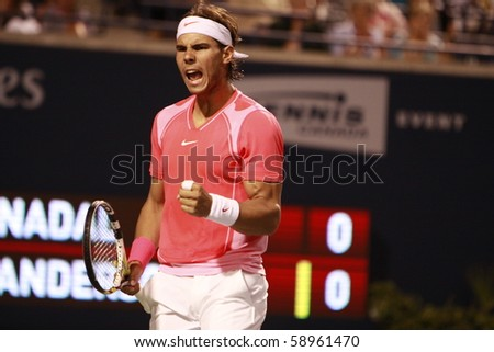 TORONTO- AUGUST 12:Rafael Nadal plays against Kevin Anderson  in the Rogers Cup 2010 on August 12, 2010 in Toronto, Canada. - stock photo
