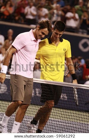 TORONTO: AUGUST 14. Roger Federer and Novak Djokovic after their tournament in the Rogers Cup 2010 on August 14, 2010 in Toronto, Canada. - stock photo