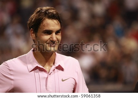 TORONTO: AUGUST 14. Roger Federer greets fans after he won a tournament with Novak Djokovic  in the Rogers Cup 2010 on August 14, 2010 in Toronto, Canada. - stock photo
