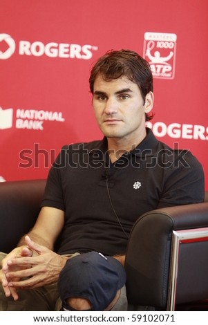 TORONTO: AUGUST 15.Roger Federer on the press conference after the tournament with Andy Murray  in the Rogers Cup 2010 finals on August 15, 2010 in Toronto, Canada. - stock photo