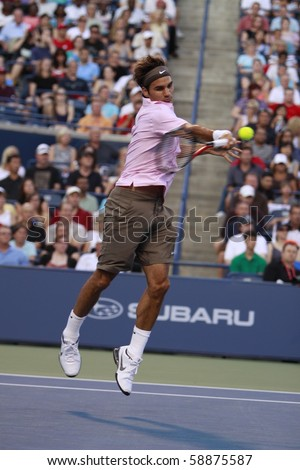TORONTO: AUGUST 10. Roger Federer plays against Juan Ignacio Chela in the Rogers Cup 2010 on August 10, 2010 in Toronto, Canada. - stock photo