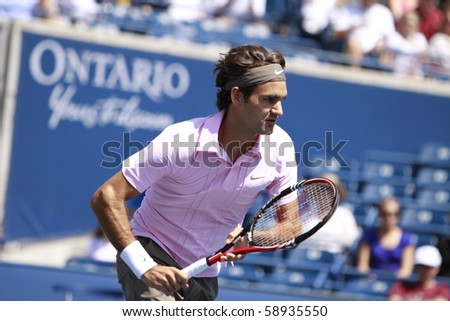 TORONTO- AUGUST 12:Roger Federer plays against Michael Llodra  in the Rogers Cup 2010 on August 12, 2010 in Toronto, Canada. - stock photo