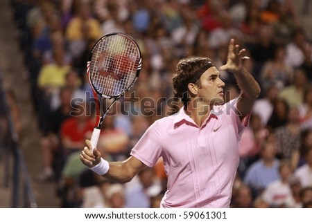 TORONTO: AUGUST 14. Roger Federer plays against Novak Djokovic  in the Rogers Cup 2010 on August 14, 2010 in Toronto, Canada. - stock photo