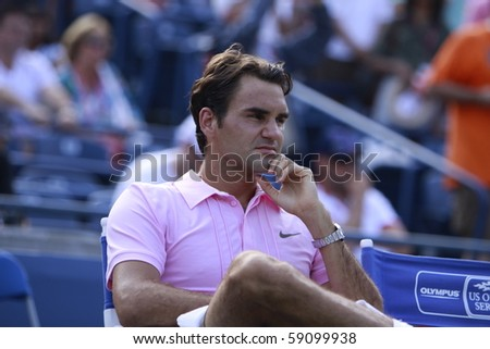 TORONTO: AUGUST 15.Roger Federer waits fro his price after tournament with Andy Murray  in the Rogers Cup 2010 finals on August 15, 2010 in Toronto, Canada. - stock photo