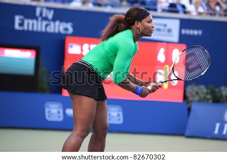 TORONTO: AUGUST 12. Serena Williams plays against Jie Zheng in the Rogers Cup 2011 on August 12, 2011 in Toronto, Canada. - stock photo