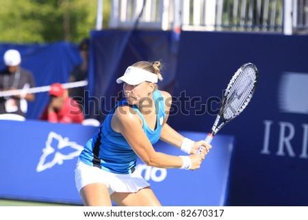TORONTO: AUGUST 12. Vera Zvonareva plays against Agnieszka Radwanska in the Rogers Cup 2011 on August 12, 2011 in Toronto, Canada. - stock photo