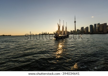 Toronto, CA, 1st July 2012. Toronto Skyline at Sunset, with a saiboat in the foreground - stock photo