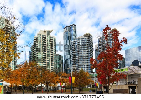 TORONTO, CANADA - 16-10-2015: A view of the elegant condominiums on the Lake Ontario in Toronto, Canada. Toronto's population about 6 million, largest city of Canada. - stock photo
