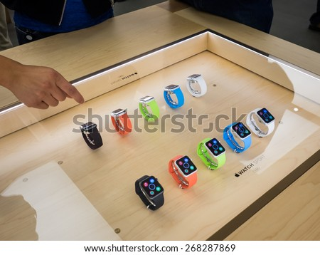 TORONTO, CANADA - APRIL 10, 2015: A couple of new Apple Watch Sport sit at the retail store. Apple begins the Apple Watch pre-order at the Canadian retail stores this day. - stock photo