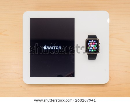 TORONTO, CANADA - APRIL 10, 2015: A new Apple Watch sits at the retail store in Toronto. Apple begins the Apple Watch pre-order at the Canadian retail stores this day. - stock photo