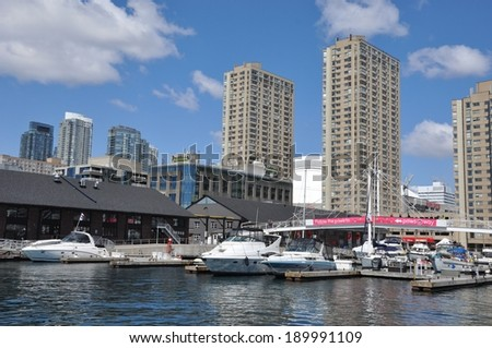 Toronto, Canada - April 27, 2014: Boats are docked in Toronto harbour signaling the start of cruise season.  - stock photo
