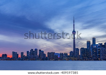 TORONTO, CANADA - APRIL 21, 2016:  Downtown Toronto skyline with the CN tower, Financial District skyscrapers and the  high-rise buildings at sunset - stock photo