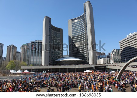 TORONTO, CANADA - APRIL 29: Sikhs gather for Khalsa day parade. Each year in Toronto, sikhs gather at the Exhibition Place and then in a huge parade walk to City Hall. April 29, 2012-Toronto, Canada.