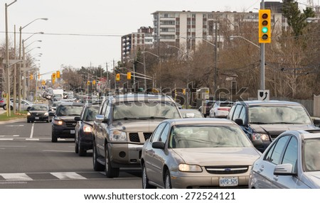 TORONTO,CANADA-APRIL 25,2015:Victoria Park Avenue is congested due to the closure for Spring maintainance of the Don Valley Parway, other affected ways are Don Mills Road,Bayview Ave.& Kingston Road