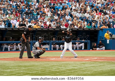 TORONTO, CANADA - AUG 28:  Reigning AL home run king Jose Bautista at bat against the Tampa Bay Rays at the Rogers Centre on August 28, 2011 in Toronto, Ontario, Canada. - stock photo