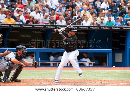 TORONTO, CANADA - AUG 28:  Reigning AL home run king Jose Bautista at bat against the Tampa Bay Rays at the Rogers Centre August 28, 2011 in Toronto, Ontario, Canada. - stock photo