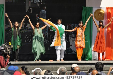 TORONTO, CANADA - AUG 13:  Unidentified dancers perform for India Independence Day at Yonge-Dundas Square August 13, 2011 in Toronto, Ontario, Canada. - stock photo