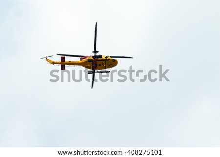 TORONTO, CANADA - AUGUST 31, 2014: A Canadian Armed Forces Search and Rescue CH-146 Griffon helicopter passes overhead under overcast skies. - stock photo