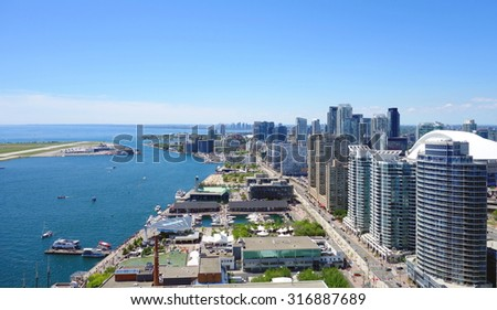 TORONTO, CANADA - AUGUST 9, 2015: A view of the elegant condominiums on the Lake Ontario in Toronto, Canada. - stock photo