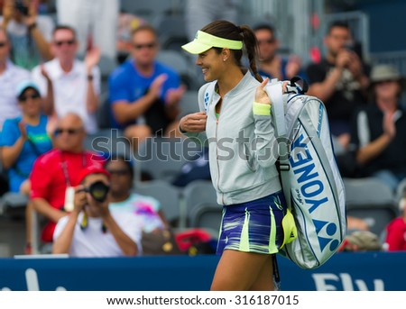 TORONTO, CANADA - AUGUST 12 :  Ana Ivanovic walks onto the court at the 2015 Rogers Cup WTA Premier 5 tennis tournament - stock photo