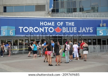Toronto, Canada - August 3, 2014: Fans are waiting in front of Rogers Centre building, the home of Toronto Blue Jays. - stock photo