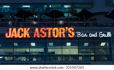 TORONTO,CANADA-AUGUST 12,2015: Signage of Jack Astor's Bar and Grill at night. Jack Astor's Bar and Grill is a chain of restaurants. It is corporately owned by Service Inspired Restaurants.