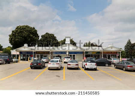 TORONTO, CANADA - 12 AUGUST 2014: Takeout shops and Fast food joints along a road in Toronto - stock photo