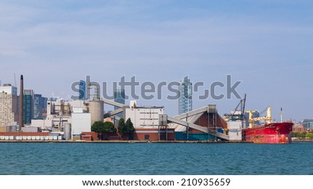 TORONTO, CANADA - 11 AUGUST 2014: The outside of the Redpath Sugar Factory in Toronto from Lake Ontario - stock photo