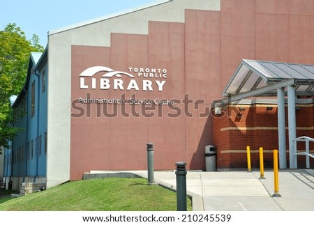 Toronto, Canada - August 3, 2014: Toronto Public Library provides free and equitable access to services which meet the challenging needs of Torontonians.  - stock photo