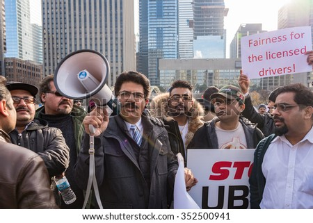 TORONTO,CANADA-DECEMBER 9,2015: Sajid Mughal, iTaxiworkers president, leads the taxi drivers protest. They are protesting againt UberX unfair competition and the lack of action by the city - stock photo