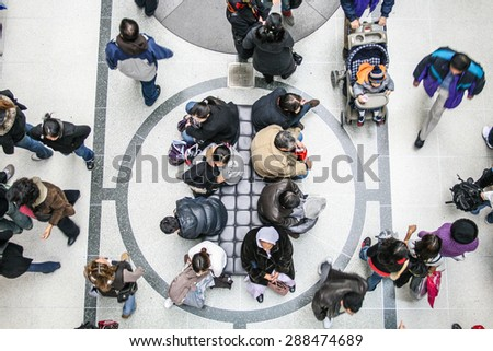 Toronto, Canada - 26 December, 2007 - the view from above of a group of people sitting in an Eaton Centre corridor, in a boxing day. - stock photo