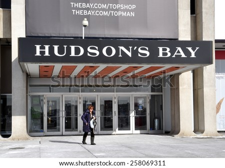 Toronto, Canada - February 24, 2015: A shopper walks fast in front of Hudson's Bay at Yorkdale Shopping Centre.