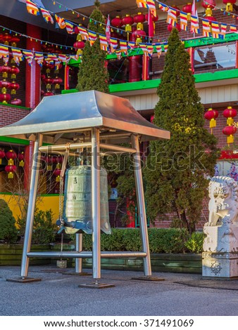 TORONTO, CANADA - February 01, 2016: Bell in Cham Shan Cham Shan is the oldest Chinese Buddhist temple in Toronto.  Each Chinese New Year, worshipers lined up to make offerings and light incense.   - stock photo