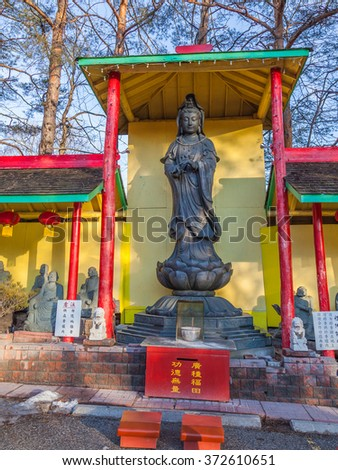 TORONTO, CANADA - February 01, 2016: Buddha statue in Cham Shan Temple  Cham Shan is the oldest Chinese Buddhist temple in Toronto, worshipers make offerings and light incense here.   - stock photo