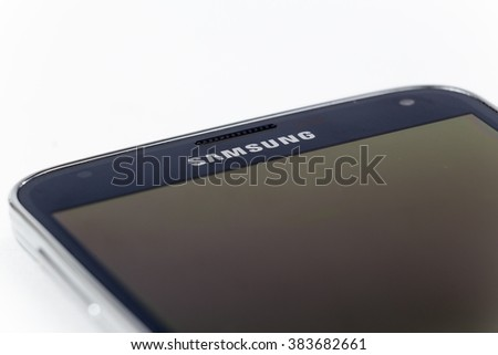 TORONTO, CANADA - FEBRUARY 10, 2016 : Closeup view of Samsung Brand Galaxy S5 mobile phone in Illustrative Editorial on a Plain Bright Background - stock photo
