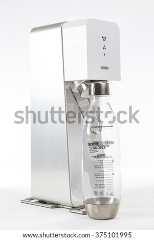 TORONTO, CANADA - FEBRUARY 9, 2016 : Sodastream Source brand of home Water Carbonation Unit in an illustrative editorial on bright background - stock photo