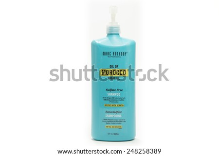 TORONTO, CANADA - JANUARY 28, 2015 : Marc Anthony Brand of Morocco Oil Women's Shampoo Hair Care Product shown on a bright background - stock photo