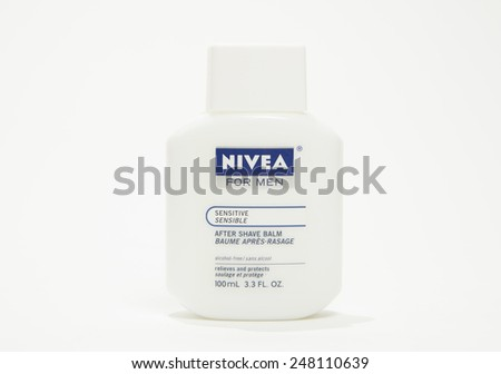 Toronto, Canada - January 28 2015 : Nivea For Men brand of Men's aftershave for sensitive skin shown on a bright background - stock photo