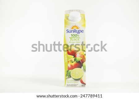 Toronto, Canada - January 27 2015 : One Litre Carton of Sun Rype brand Apple-Lime flavoured apple juice shown on a bright background - stock photo