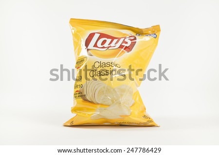 Toronto, Canada - January 27 2015 : Small Foil Bag of Lay's Brand Original Flavor Potato Chips shown on a bright background - stock photo