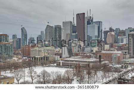 TORONTO, CANADA - JANUARY 14, 2016: Winter view from a high-rise building of Moss Park Arena and Toronto Financial District skyscrapers - stock photo