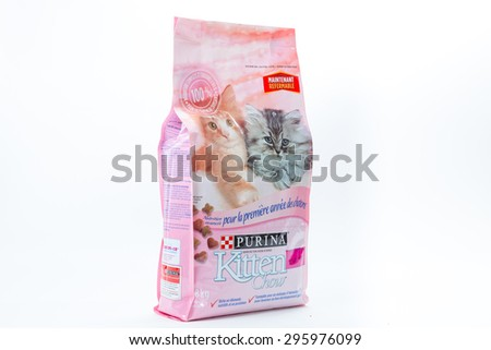 TORONTO, CANADA - JULY 12, 2015 : Bag of Purina Kitten Food for young cats shown over a bright background in an illustrative editorial image - stock photo