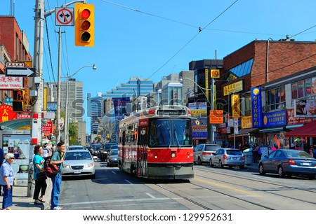 TORONTO, CANADA - JULY 2: Chinatown street view on July 2, 2012 in Toronto. It is one of the largest Chinatowns in North America and Chinese-Canadian Communities in Great Toronto Area. - stock photo