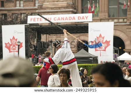 Toronto, Canada - July 1, 2013: Citizens of Toronto gathered at Queen's Park to celebrate Canada Day.  - stock photo