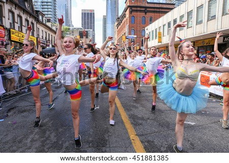 TORONTO, CANADA - JULY 3, 2016: Dancers performing while marching at Toronto Pride Parade.