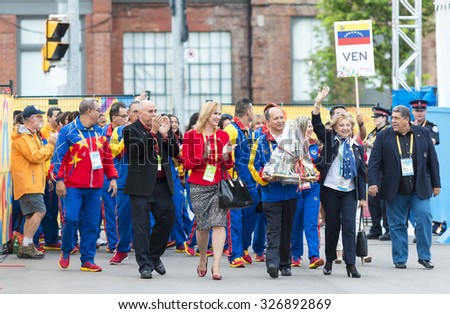 TORONTO,CANADA-JULY 8,2015:Delegates and athletes from Venezuela walking with a souvenir to be presented to the officials of the host country during the Pan Am Games welcoming ceremony.