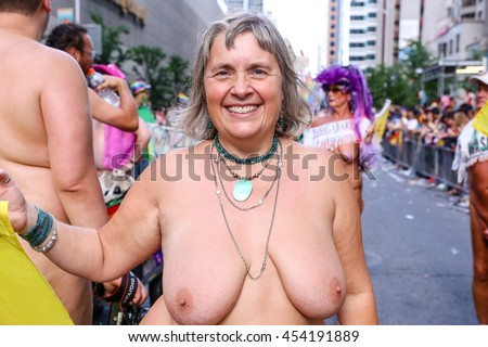 TORONTO, CANADA - JULY 3, 2016: Member of Federation of Canadian Naturists march at Toronto Pride Parade.  - stock photo