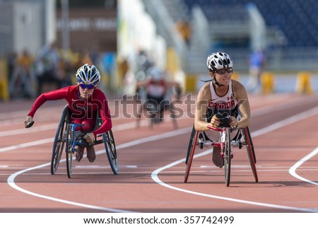 TORONTO,CANADA-JULY 8,2015: Michelle Stilwell wins Gold Medal in Women's 100m T52 Final with a time of 19.58 during the 2015 Toronto Parapan Am Games  - stock photo
