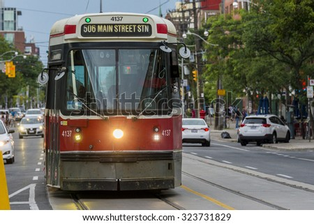TORONTO,CANADA-JULY 1,2015:Old vintage Bombardier streetcar in downtown. Toronto streetcar system comprises eleven streetcar routes in Toronto, operated by Toronto Transit Commission - stock photo