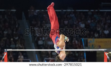 TORONTO,CANADA-JULY 15,2015: Paul Ruggeri from US gets third place in the Men Horizontal Bar during the Gymnastic Artistic competition of the Toronto Panam Games 2015. CN 01953074